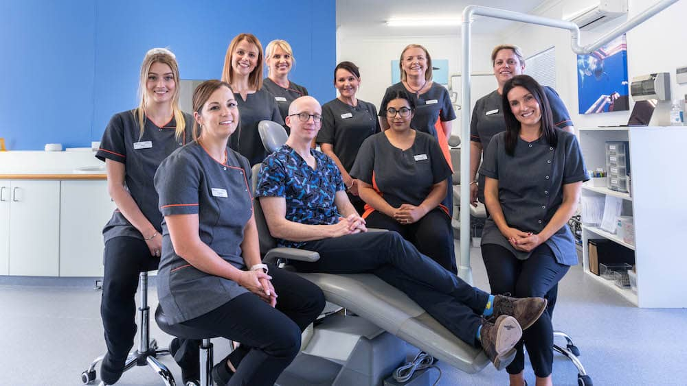 The Oasis and Kingsley Orthodontics team ready to treat patients.